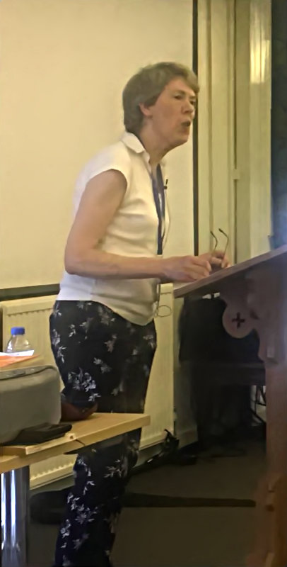 Anne Harrison speaking about the history of the Jubilate Music Group at Conference in Carmarthen